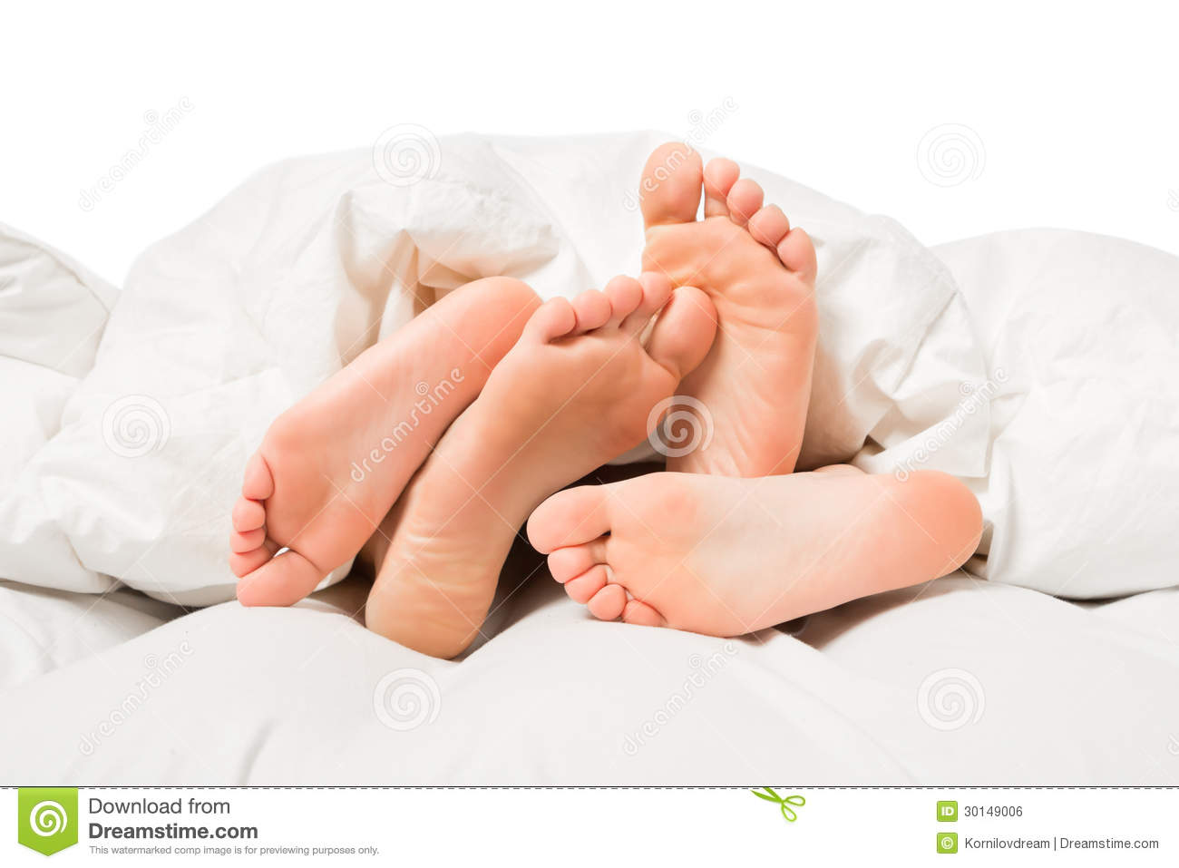 Feet In A Bed Royalty Free Stock Image - Image 30149006-4008