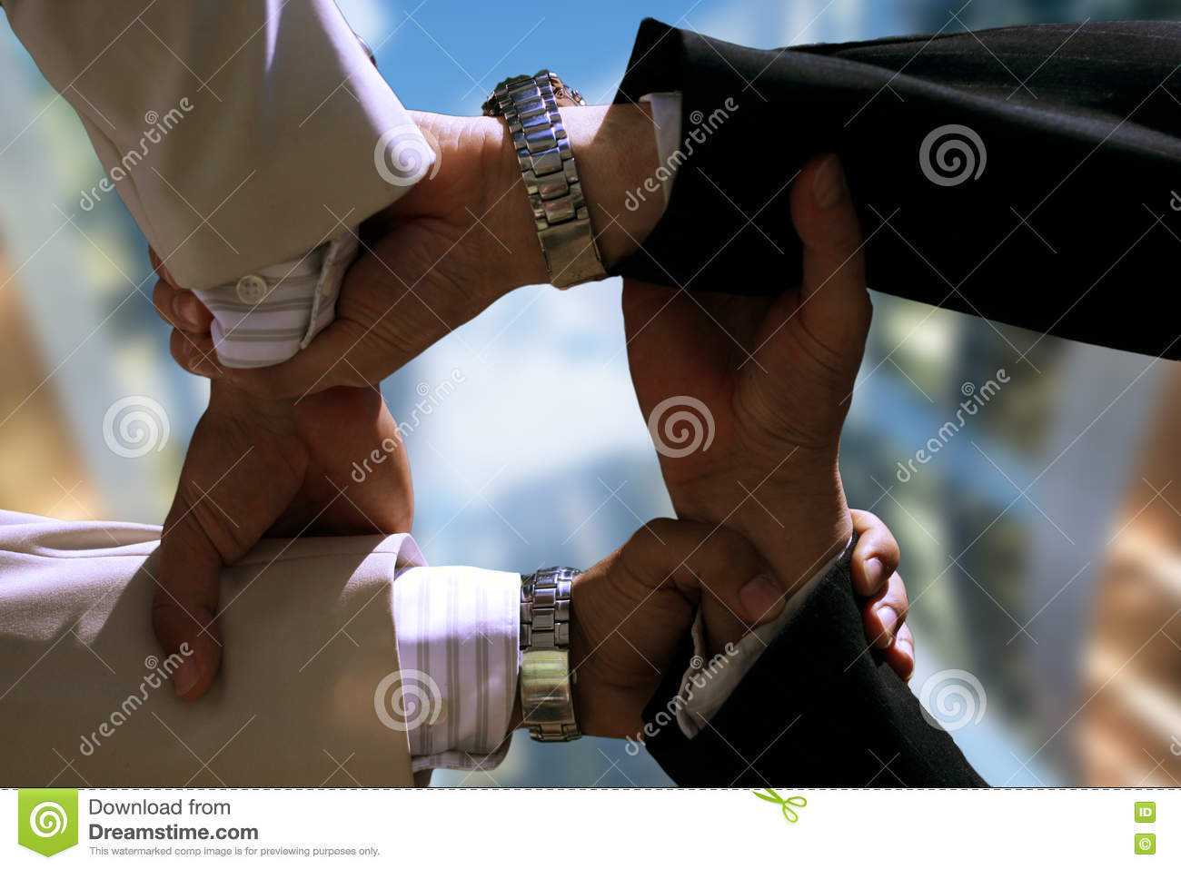 Close-up four hand grip of businesspeople