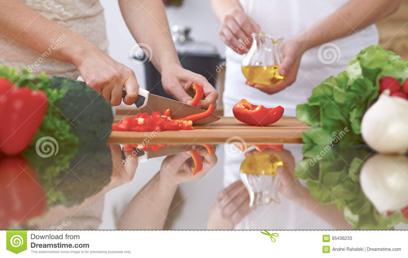 Close up of four human hands are cooking in a kitchen for Fresh chef kitchen