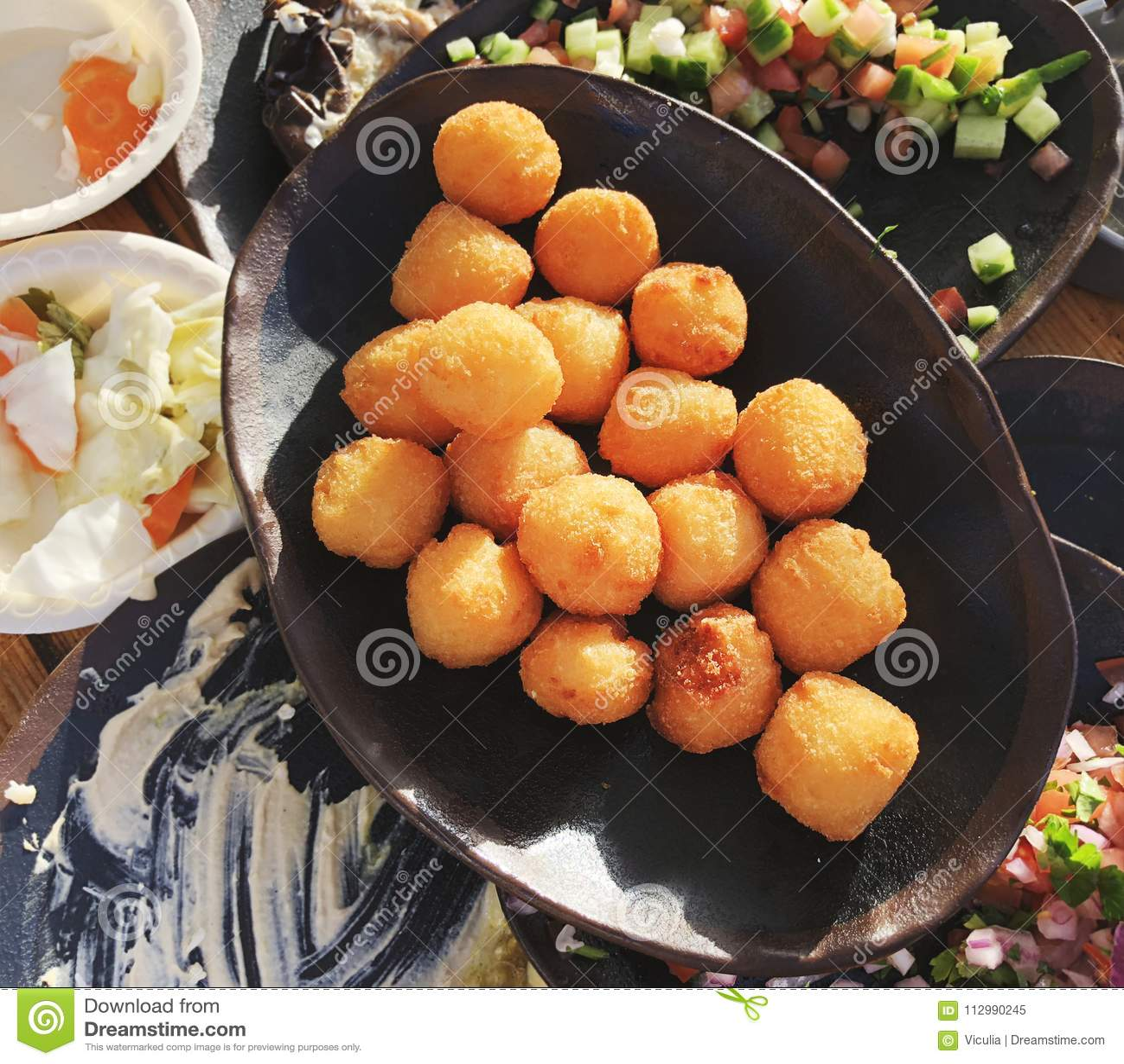 Close up of frieds sweet potato balls on plate.