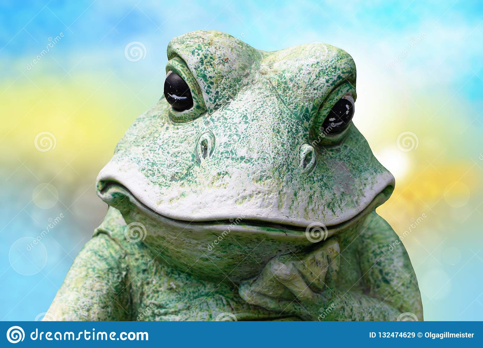 Close-up of frog head. A decorative old weathered ceramic frog o