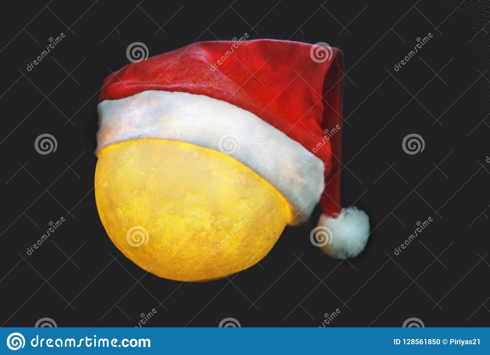 944d46504 Close Up Full Moon Wears Santa Claus Hat With Black Background ...