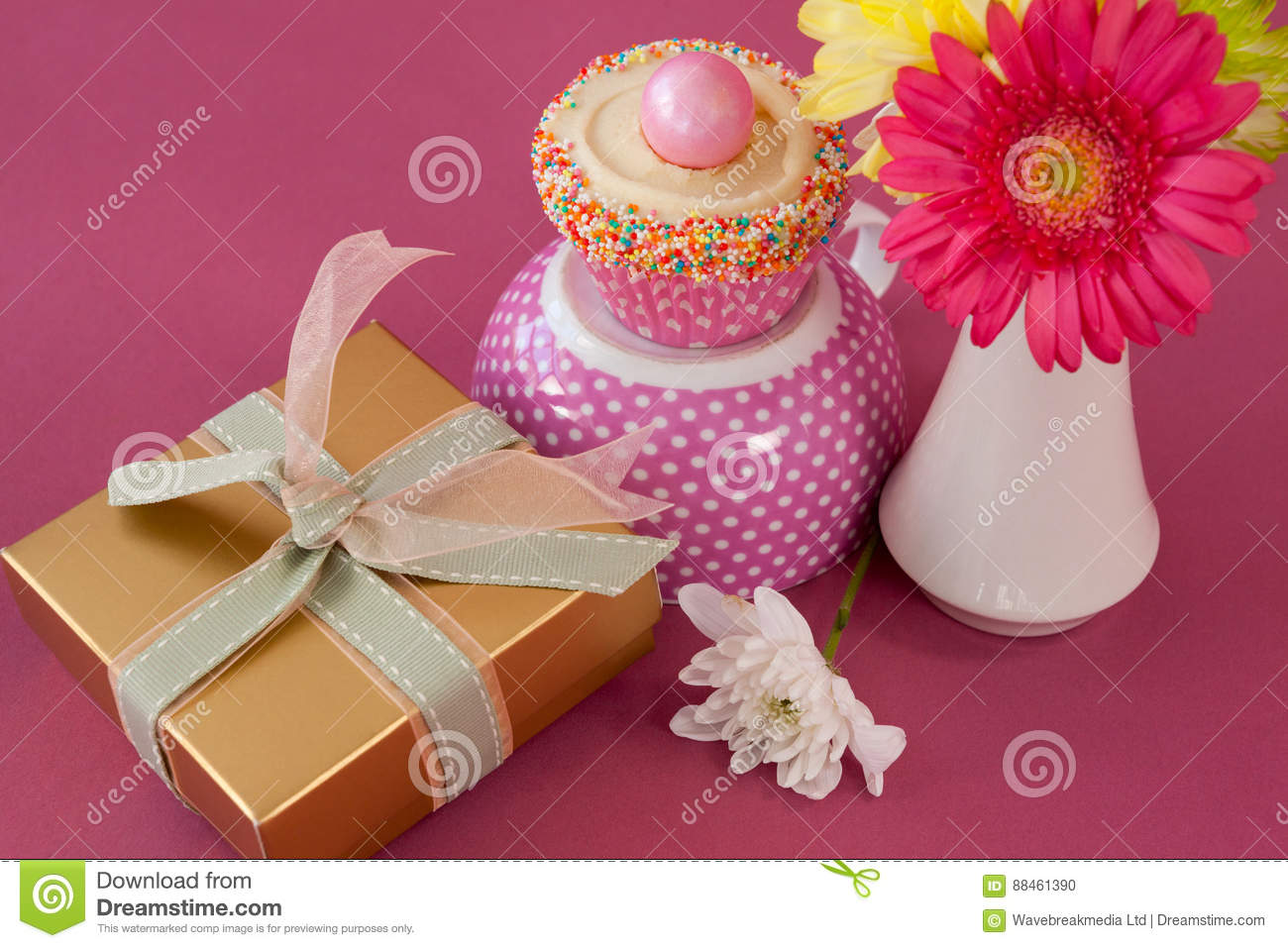 Close-up Of Gift Box, Cupcake And Flowers Vase Stock Photo - Image ...