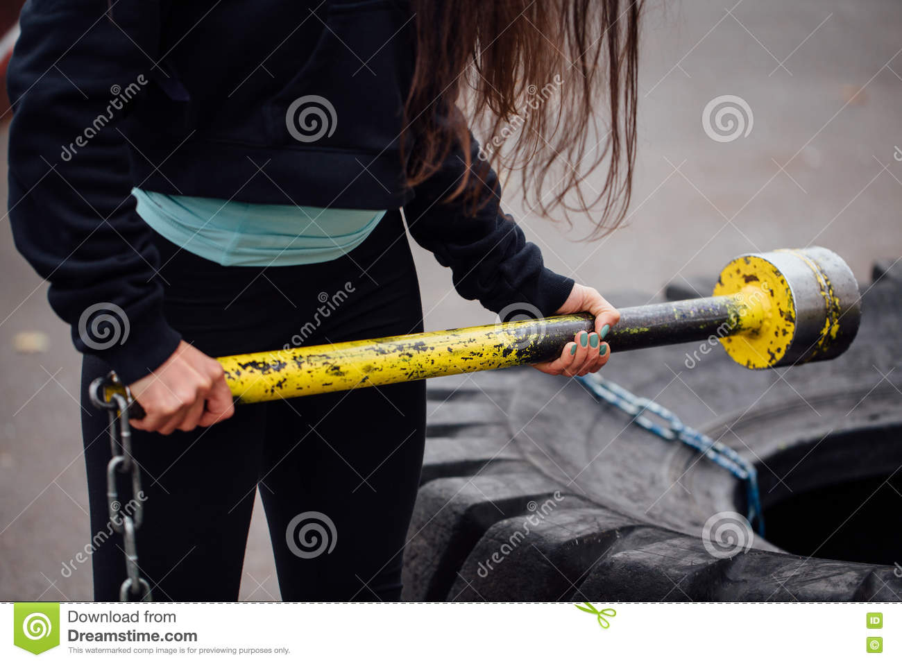 Close Up Girls Hands At Park With Hammer On Tractor Tire Background