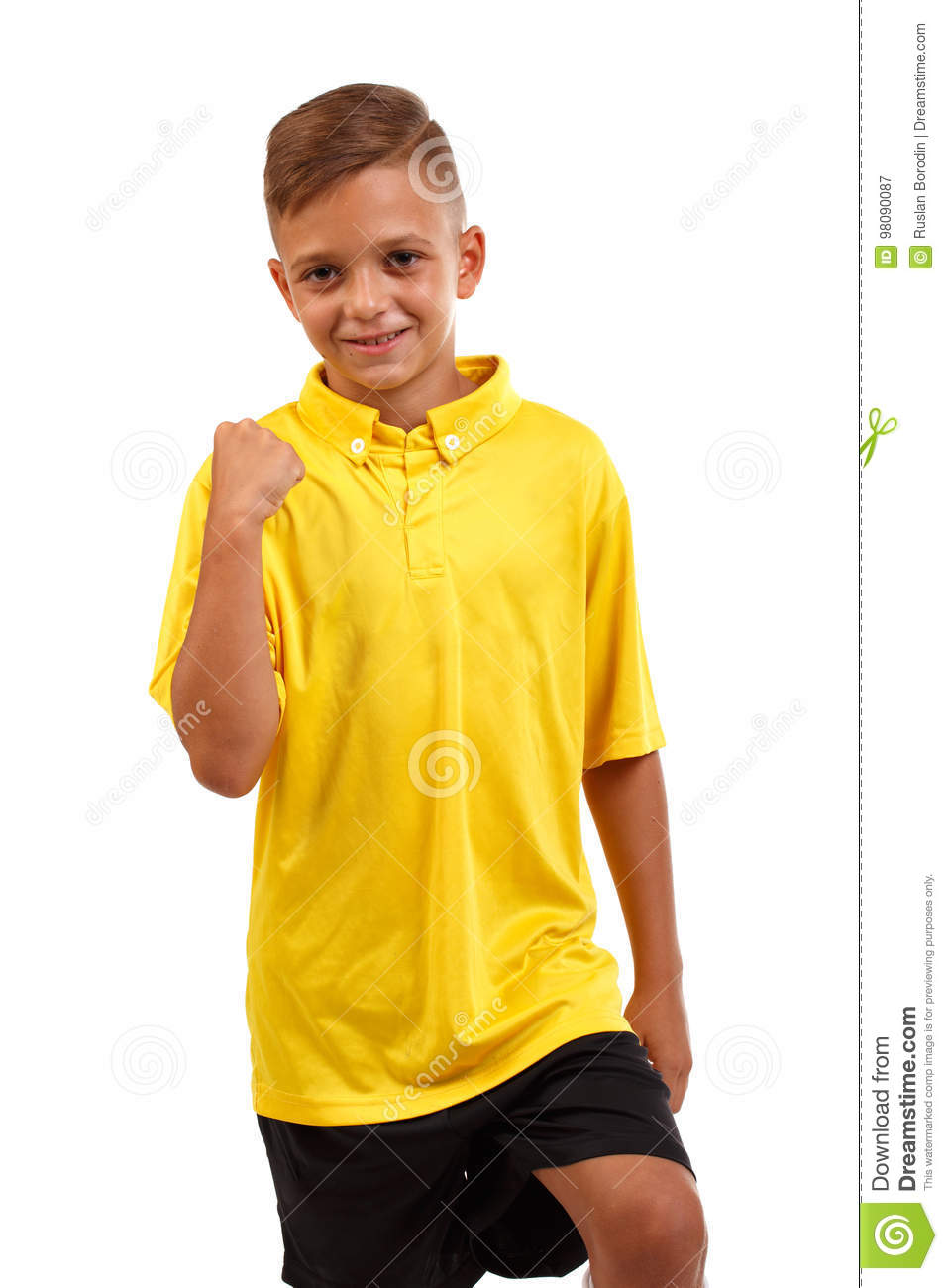 Close-up of a glad boy who won the championship. A cheerful child in a football uniform isolated on a white background