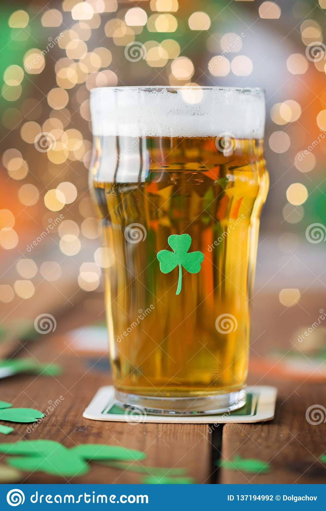 Close Up Of Glass Of Beer With Shamrock On Table Stock Photo Image Of Beer Light 137194992