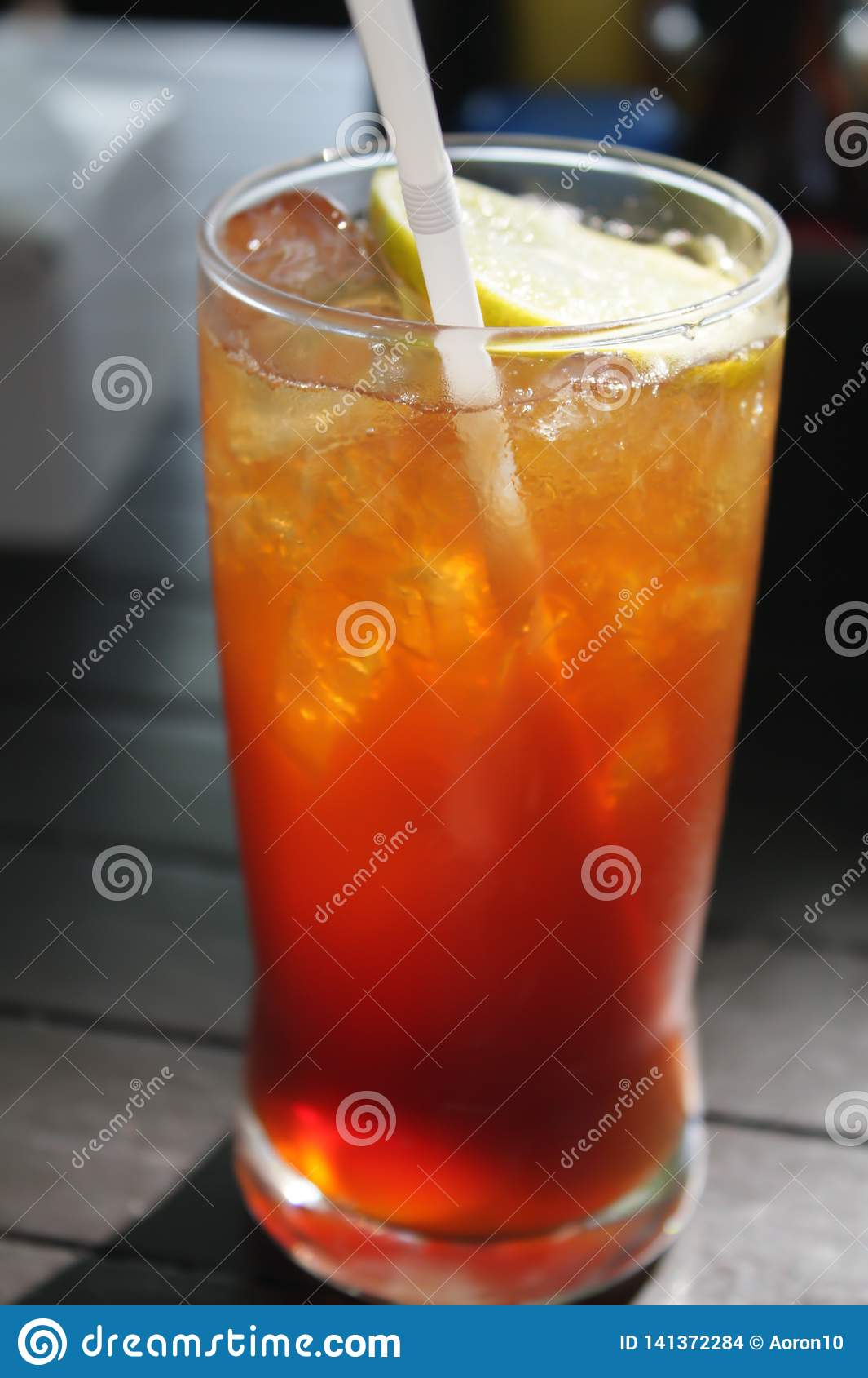 Glass of lemon tea. And ice Located on the wooden table