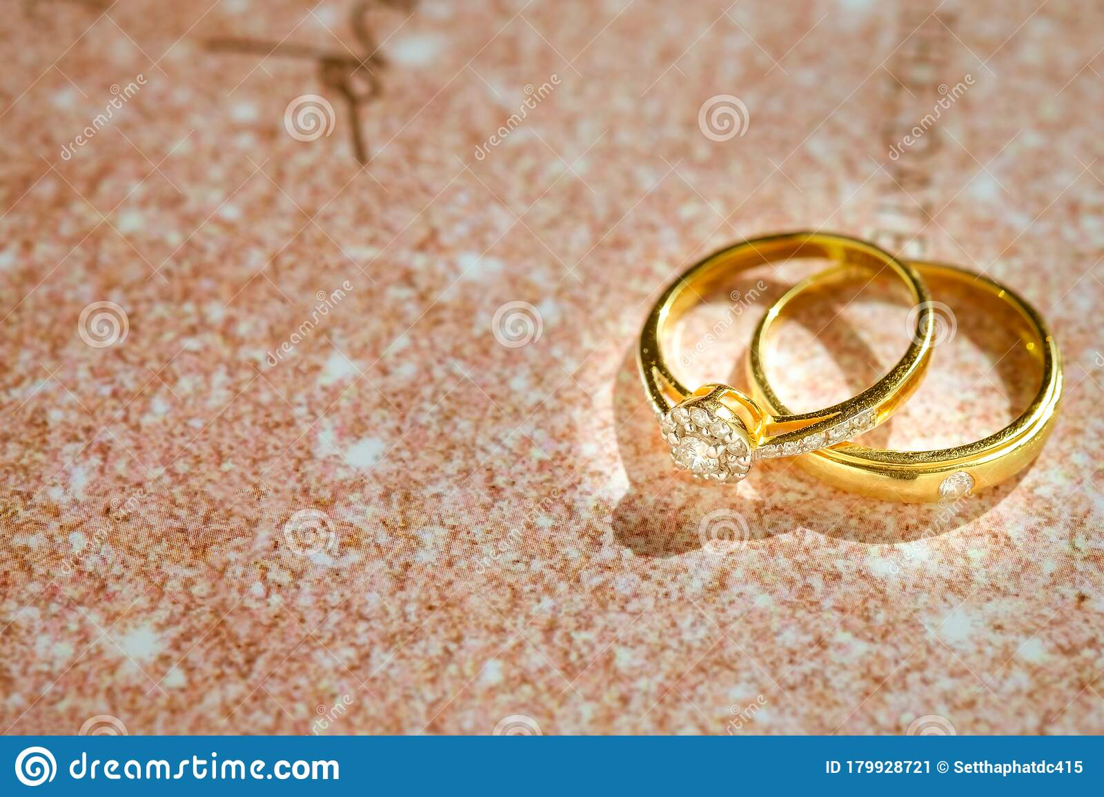 Close Up Of Gold Wedding Rings Or Engagement Rings On Wedding Invitation Card Background Stock Image Image Of Celebration Card 179928721