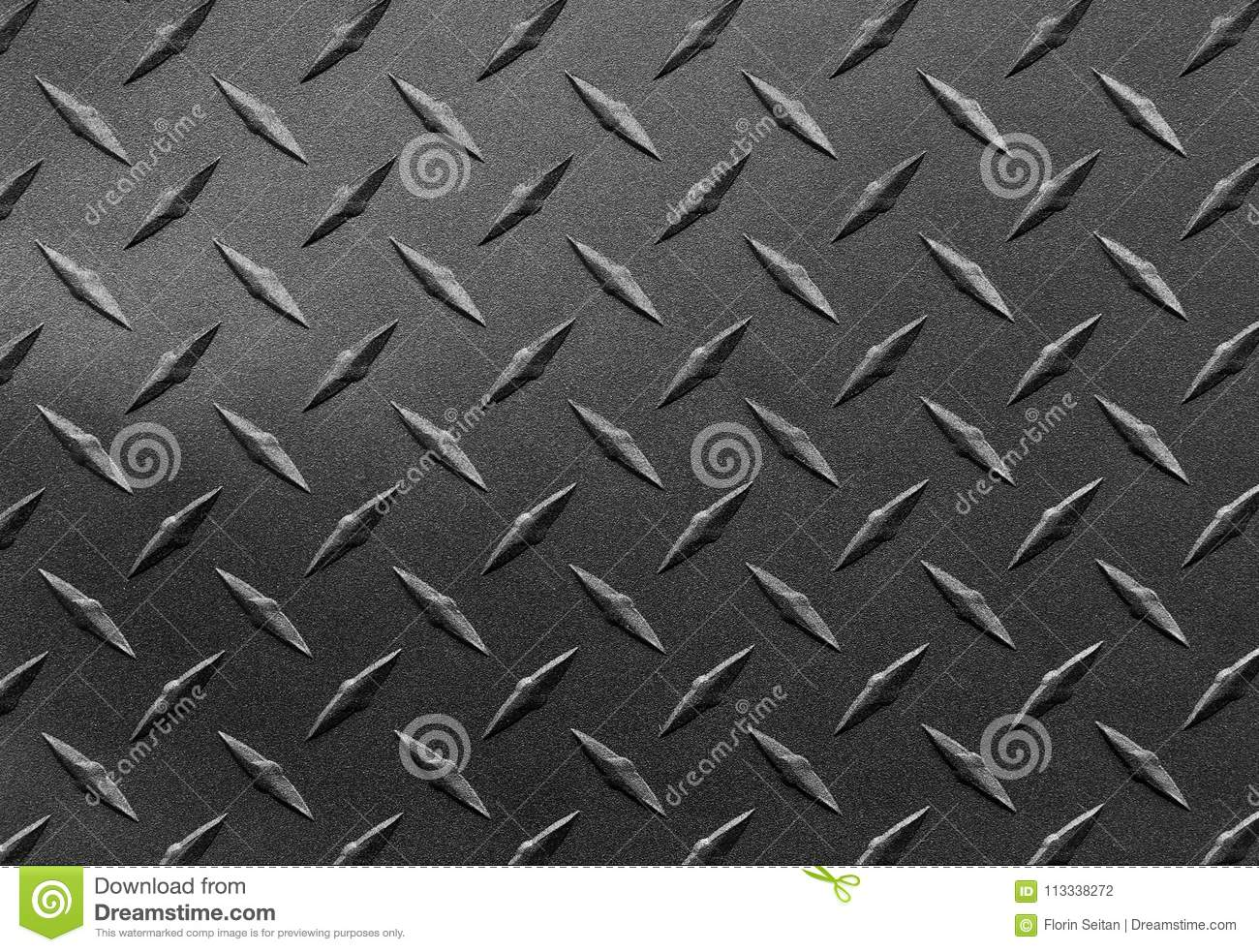 Close up of grainy textured steel sheet with diamond plate pattern, metallic background