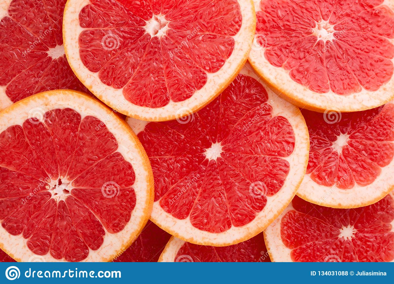 Close-up Grapefruit slices abstract background in Living Coral color