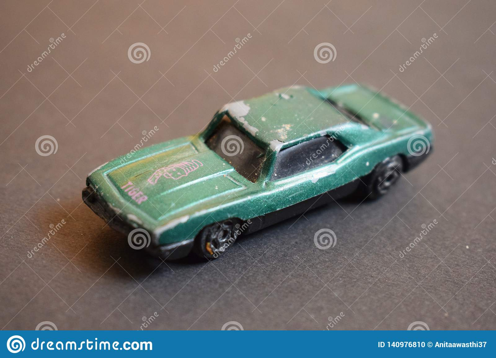 Close up of green coloured destroyed toy car.
