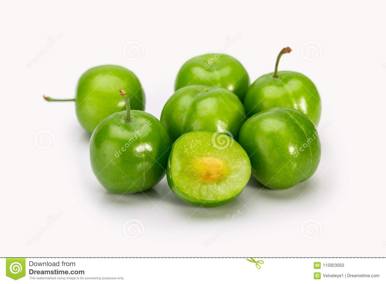 Close Up Of Green Plums Or Greengage showing the flesh and the s