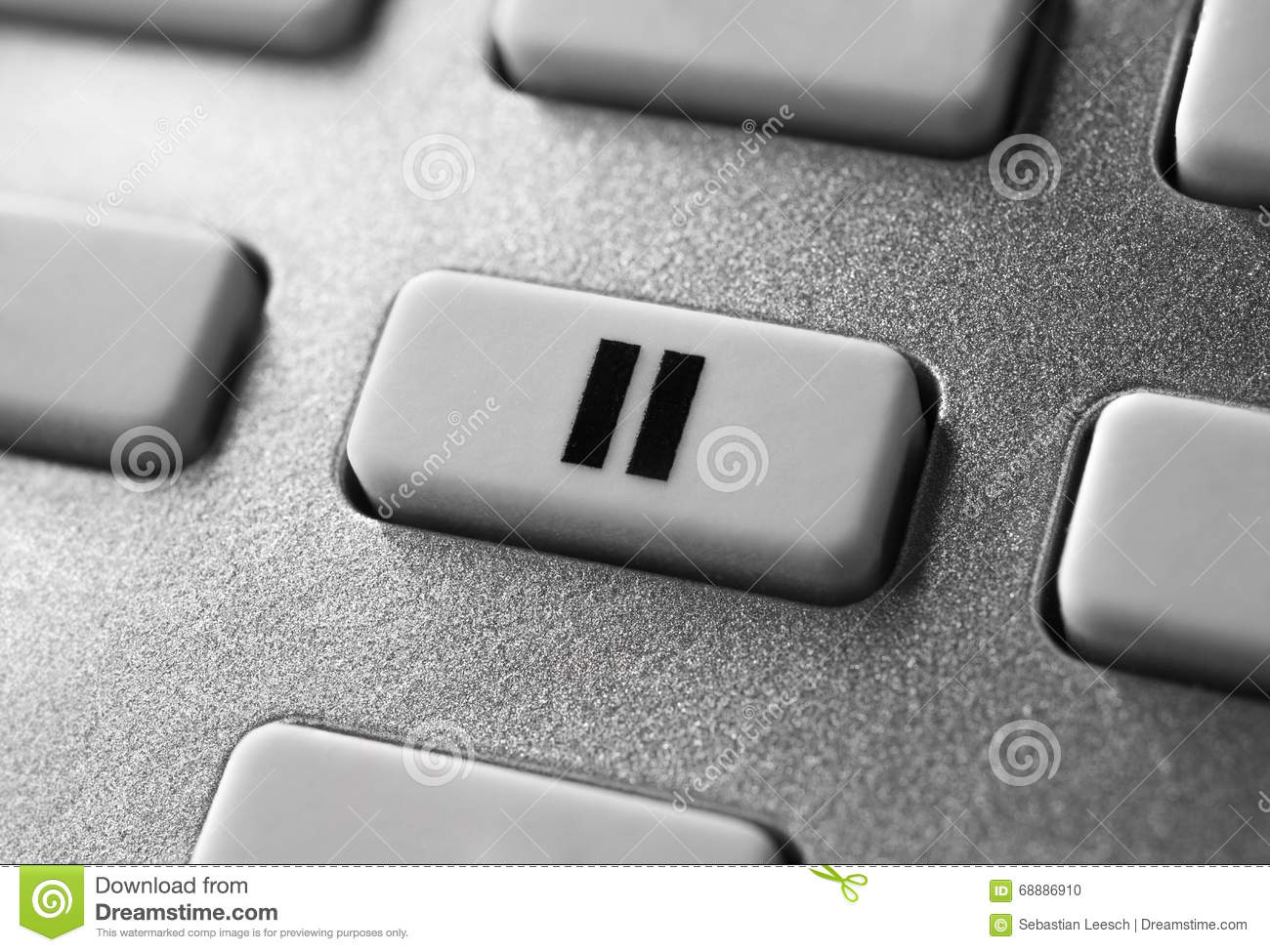 Close Up Of A Grey Pause Button On Chrome Remote Control For A Hifi Stereo Audio System