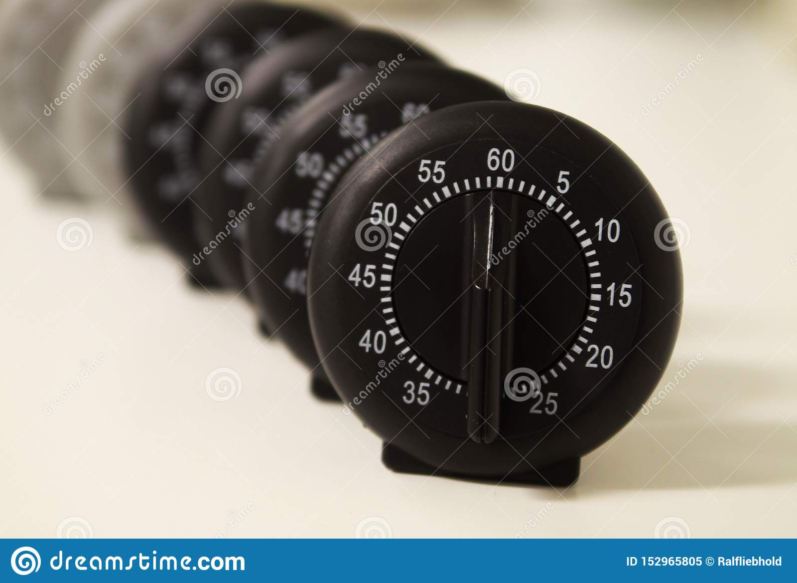Close up of a group of analog stop watches
