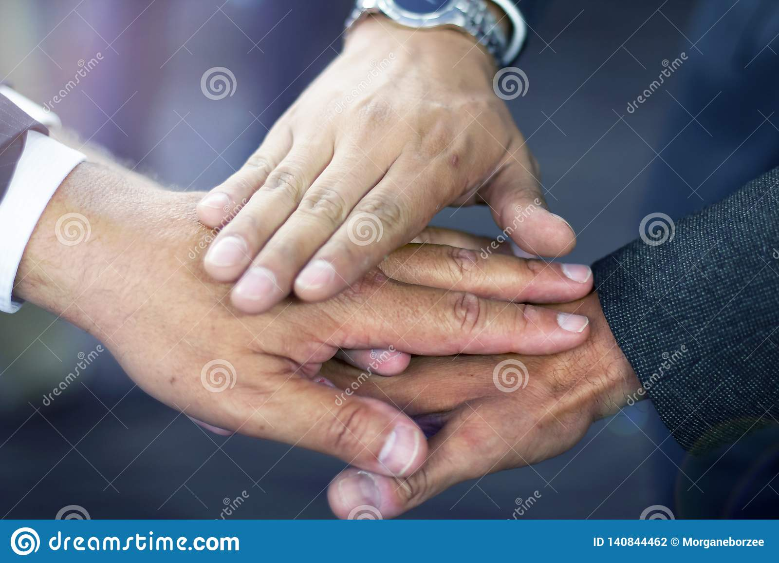Close up of hispanic business man joining hands