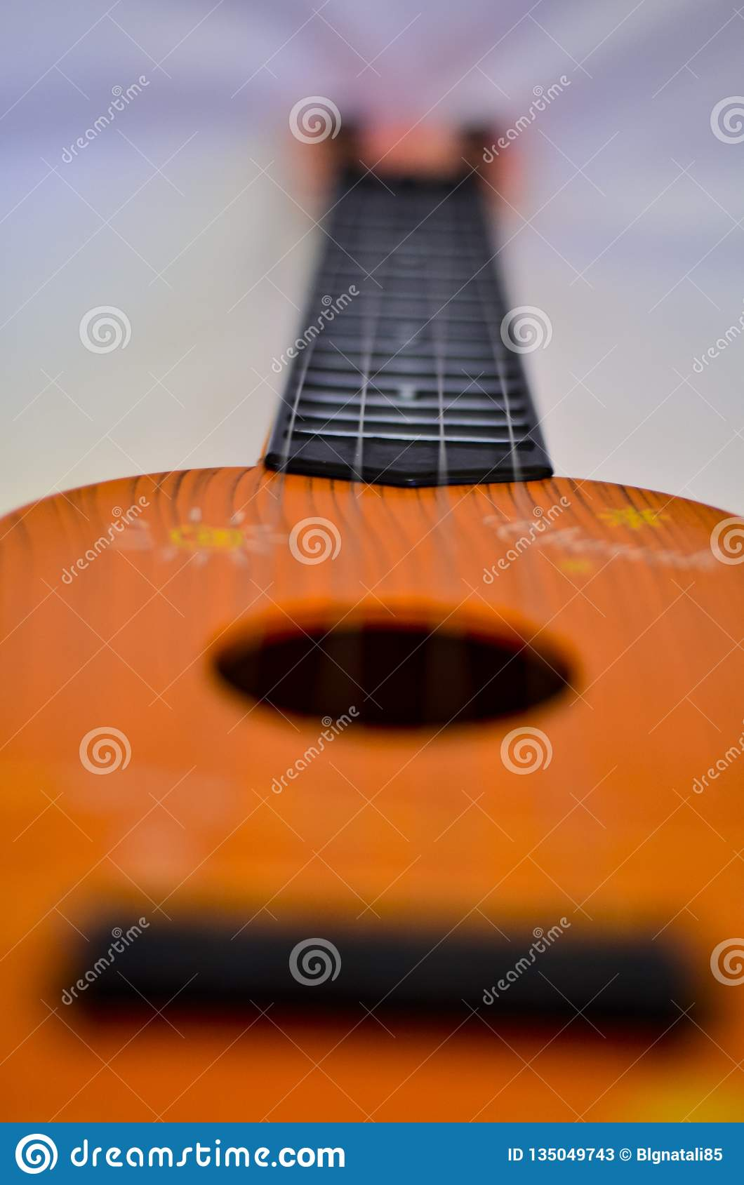 Close-up of a guitar string with a soft blurred background.