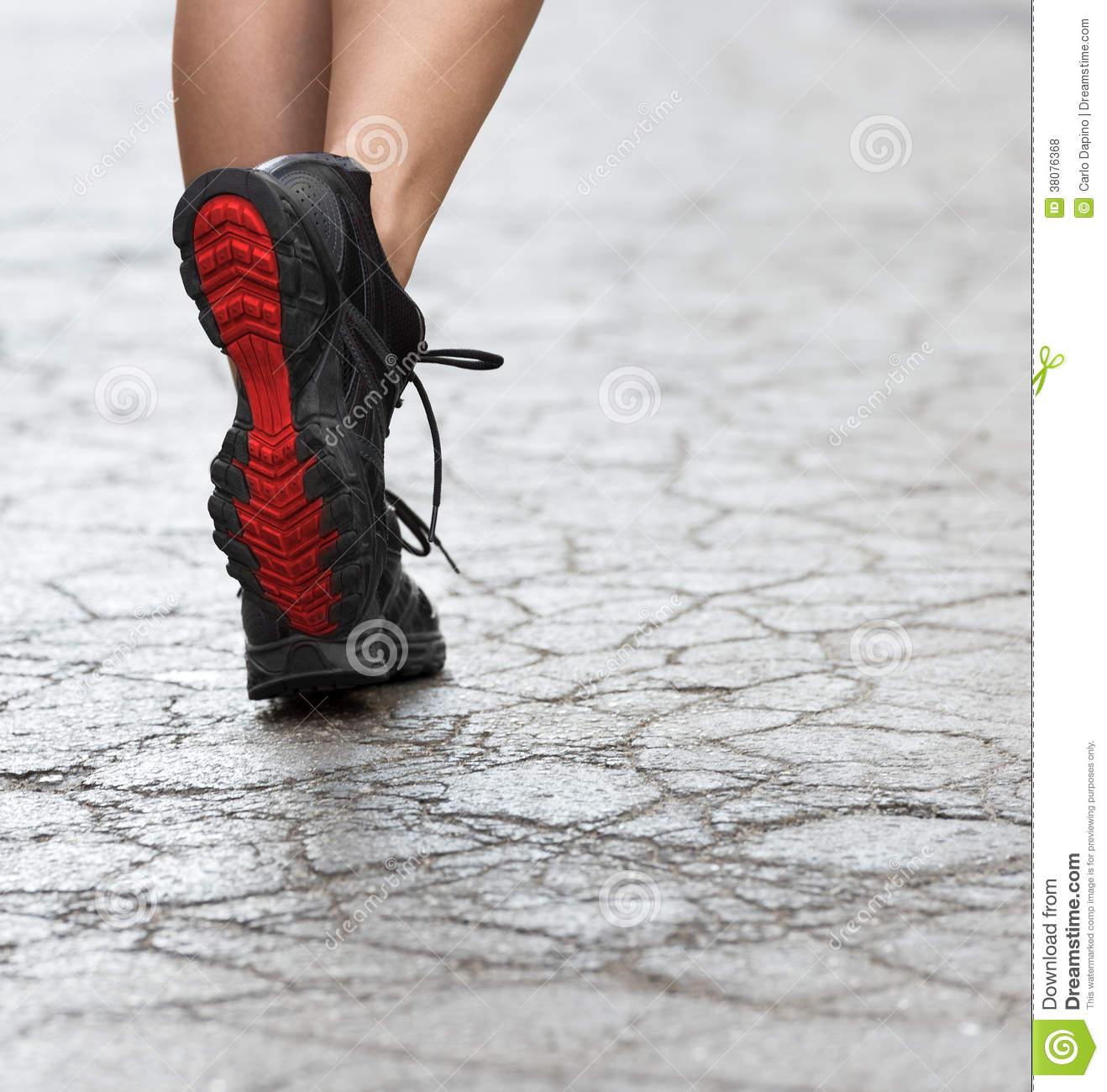 Close up on gym shoes on crack street royalty free stock for Lady fitness