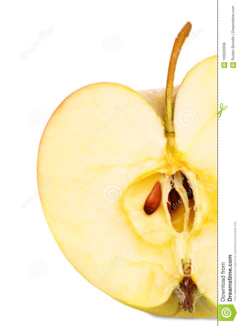 Close Up Of An Apple In A Cut Shape Isolated On A White
