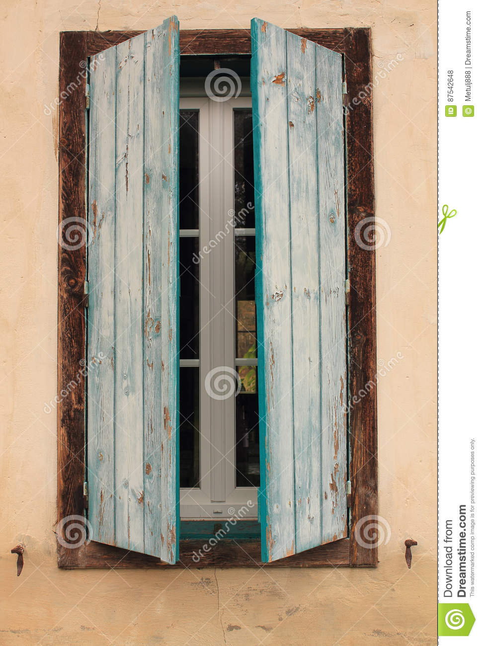 Close Up Of Half Opened Rustic Blue Old Window Shutters On A