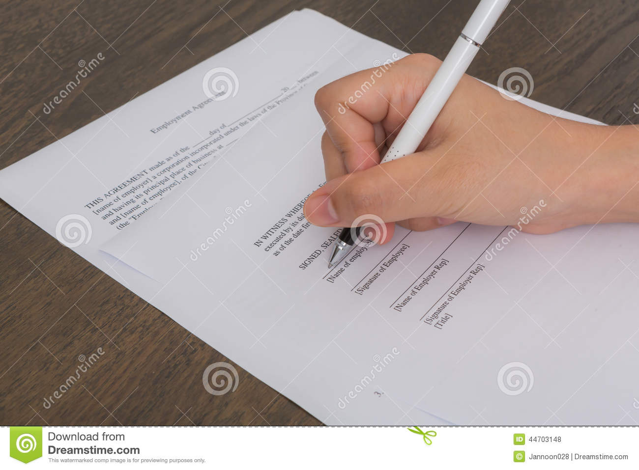 close up of hand completing an employment stock photo image close up of hand completing an employment