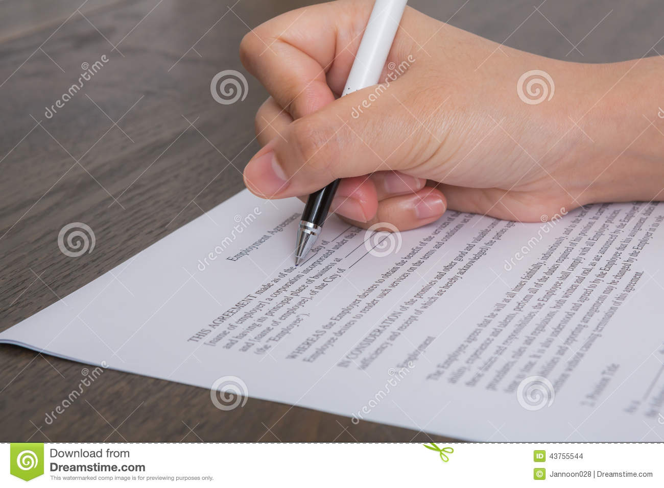 close up of hand completing an employment application form stock close up of hand completing an employment application form