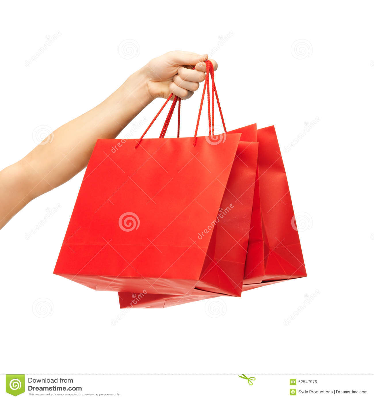 Close up of hand holding red shopping bags