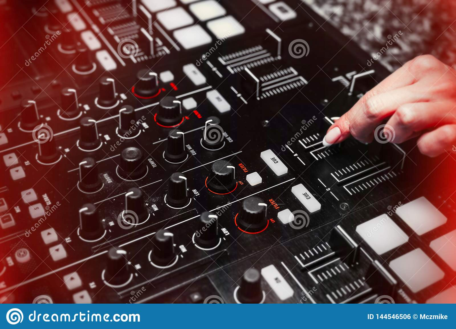 Close up of Hand Increasing Sound of DJ Instrument, Moving Fader.