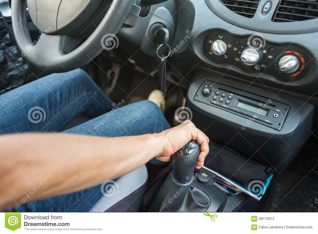 close up of hand on manual gear shift knob stock photo image 56110212. Black Bedroom Furniture Sets. Home Design Ideas