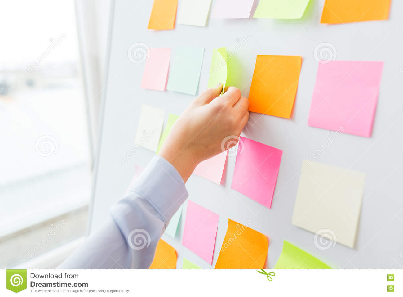Close up of hand pointing to sticker on flip chart stock photo