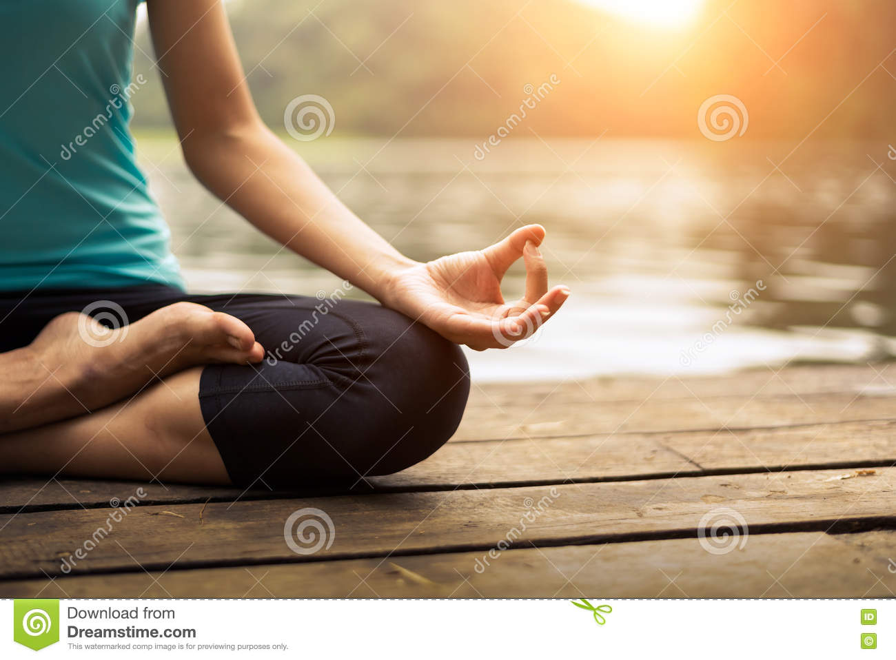 Close up hand. Woman do yoda outdoor. Woman exercising yoga at the nature background.