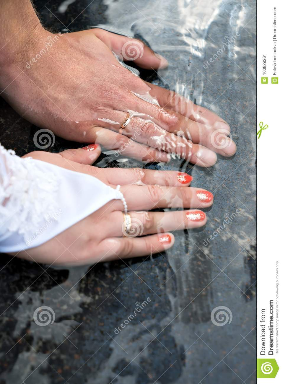 Close-up Of Hands Of Newlyweds With Wedding Rings Stock Image ...
