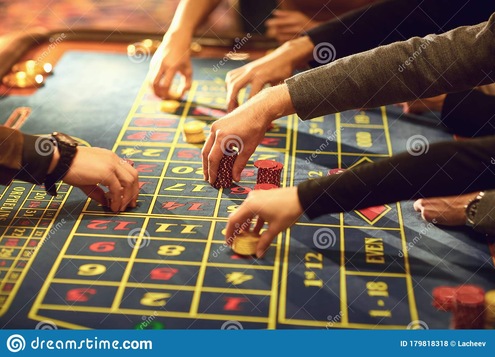 Gamblers placing their bets at a roulette table