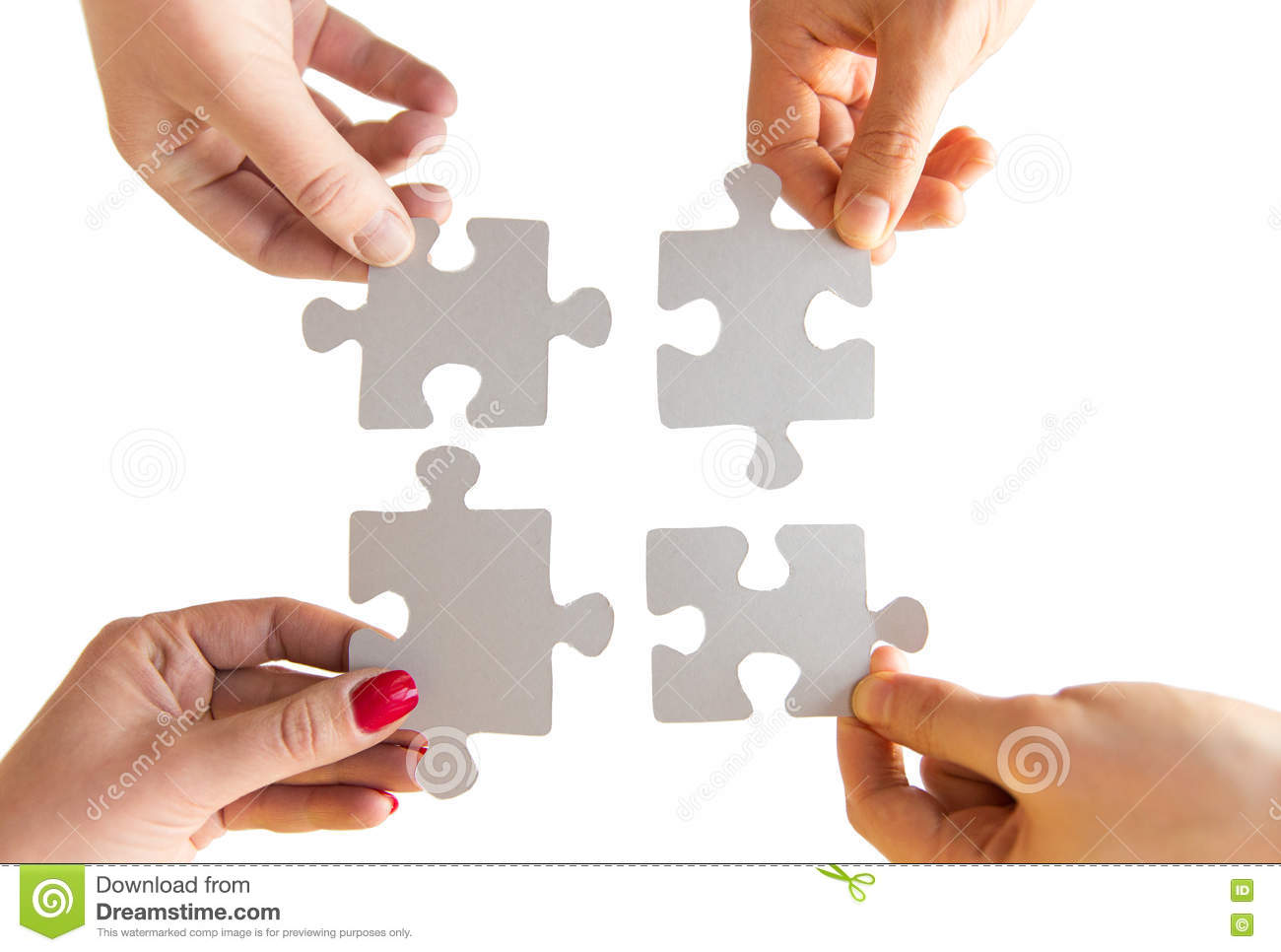 close up of hands connecting puzzle pieces stock photo image of