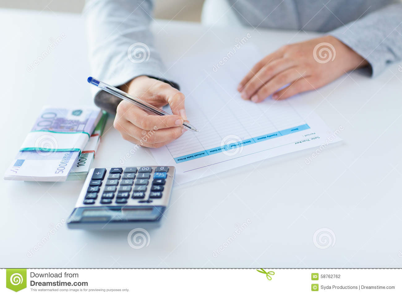 Close Up Of Hands Counting Money With Calculator Stock