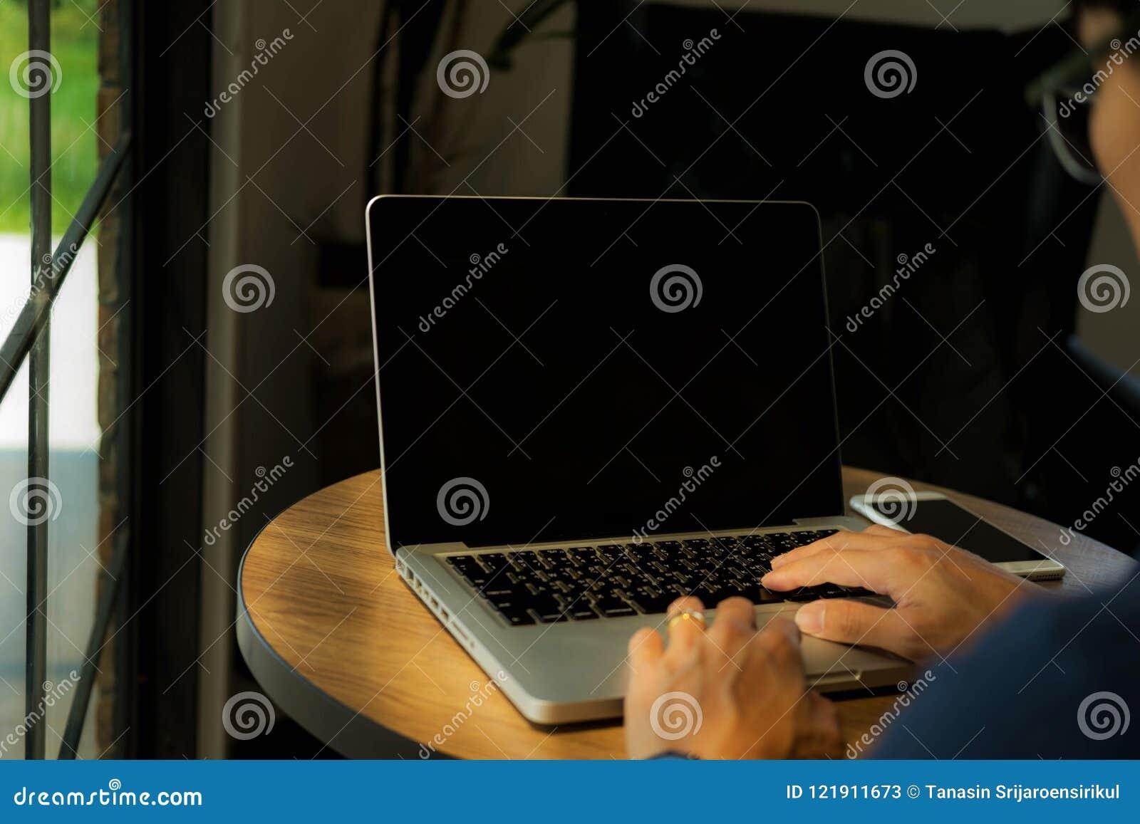 Close up hands man using laptop .