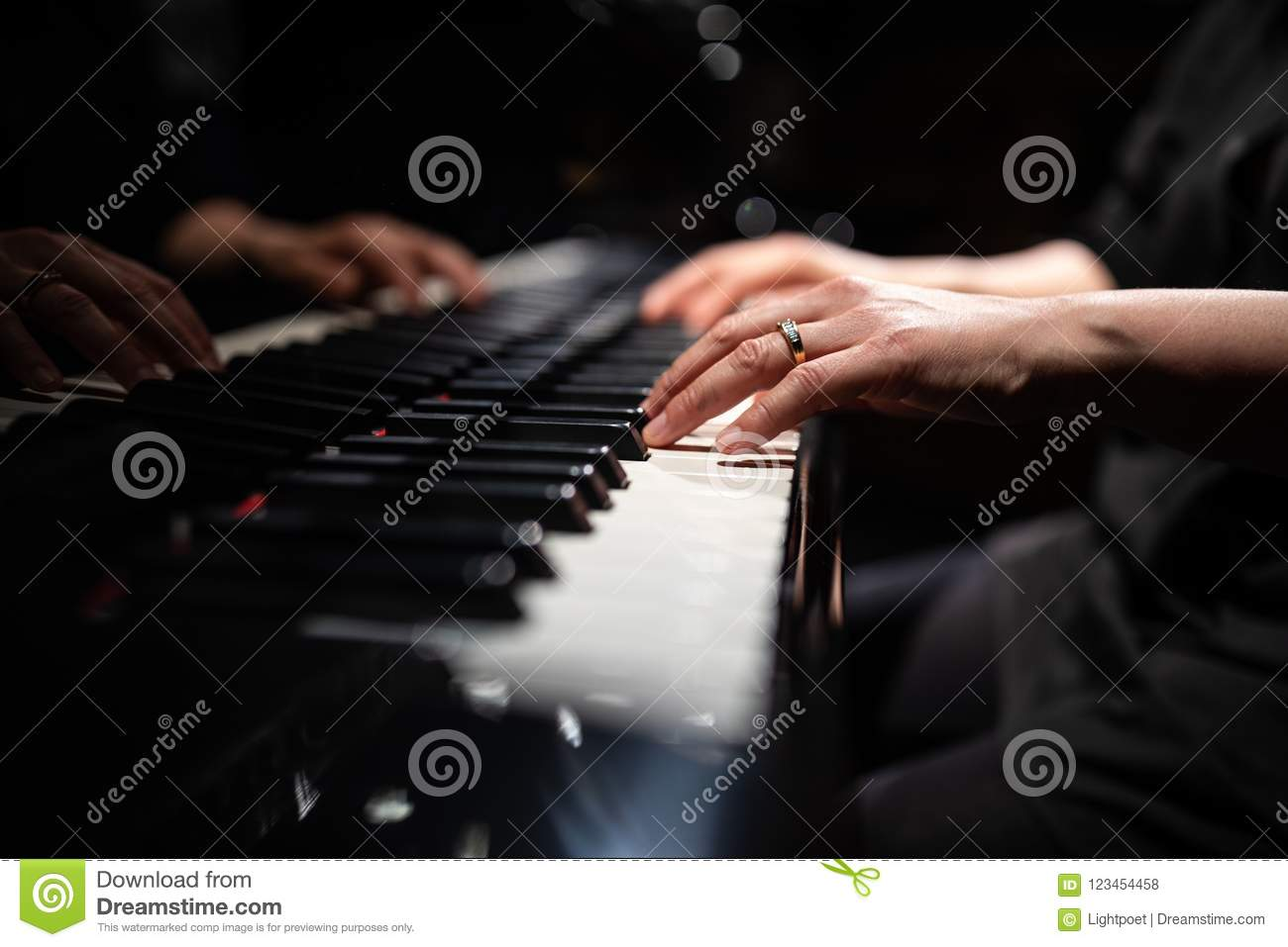Close up of hands of piano player