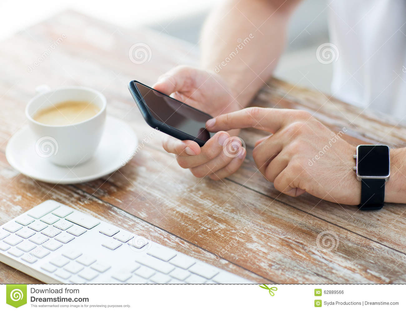 Technology Management Image: Close Up Of Hands With Smart Phone And Watch Stock Photo