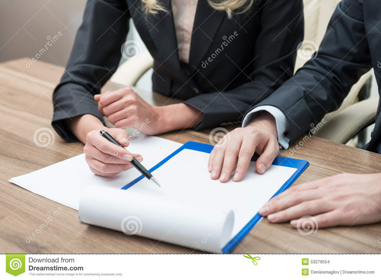 Close up hands of working process. Legal contract negotiation.