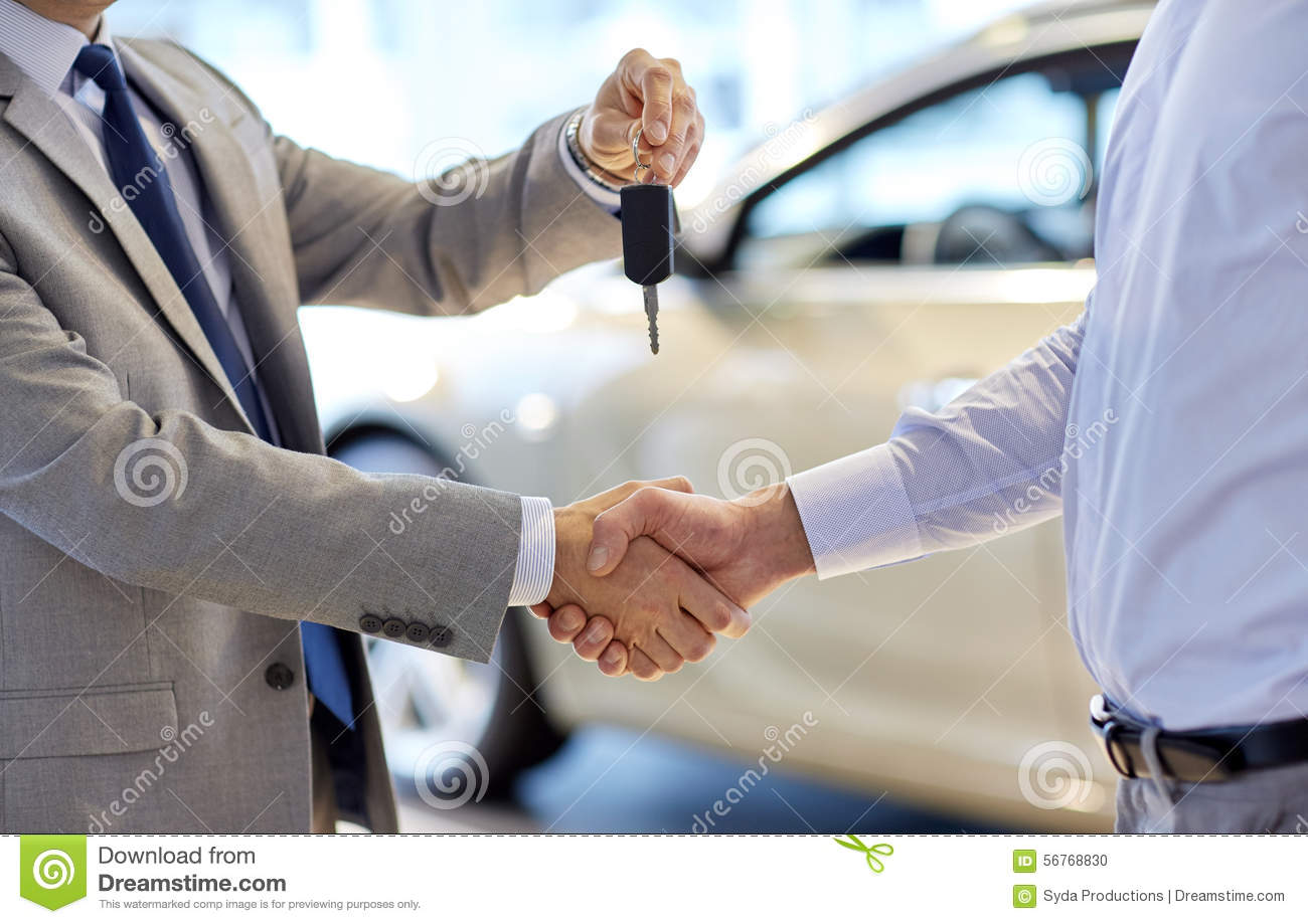 close up of handshake in auto show or salon stock photo image of gesture contract 56768830. Black Bedroom Furniture Sets. Home Design Ideas