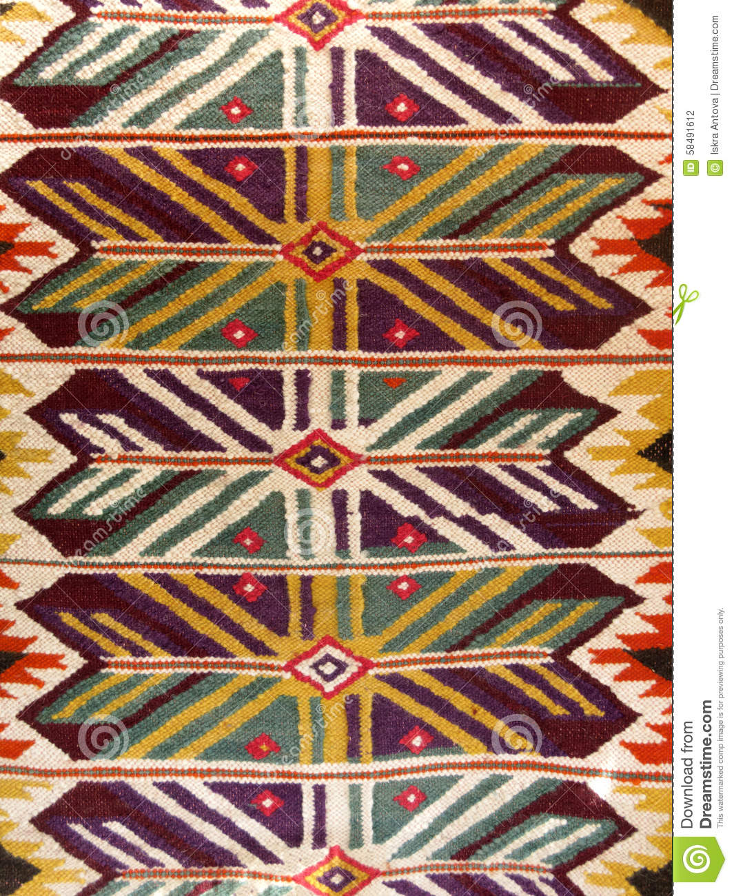Close up of a hanged colourful handmade traditional wool rug