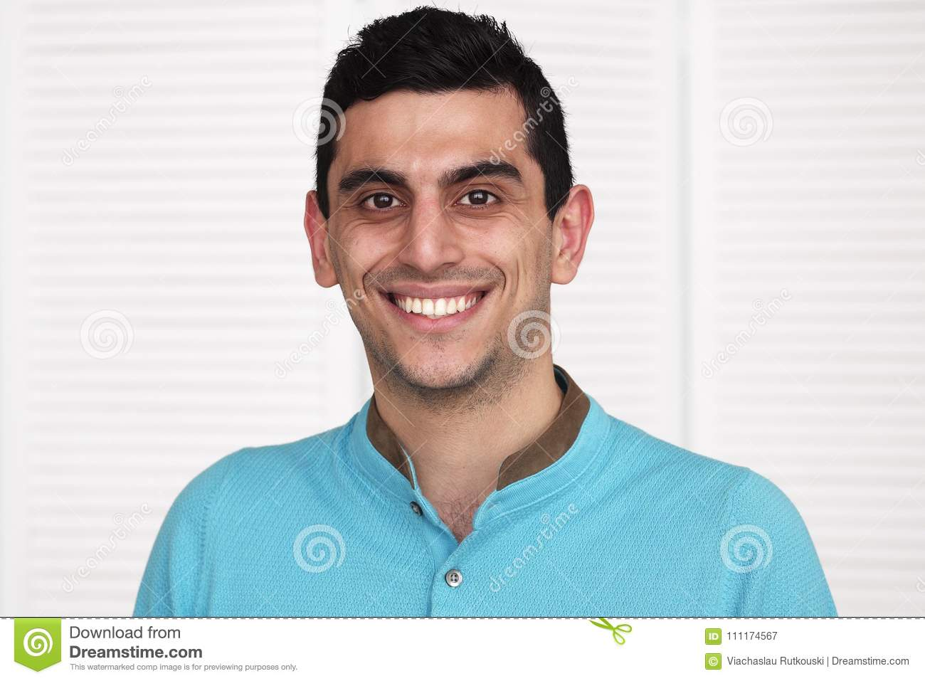 Close-up of a happy arabic man smiling