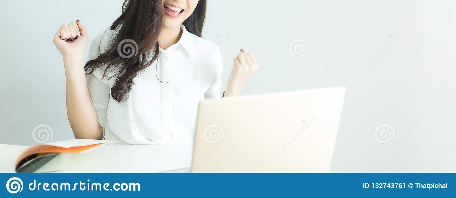 Close up of happy young business woman finished her work with laptop computer in modern office. Banner with copyspace