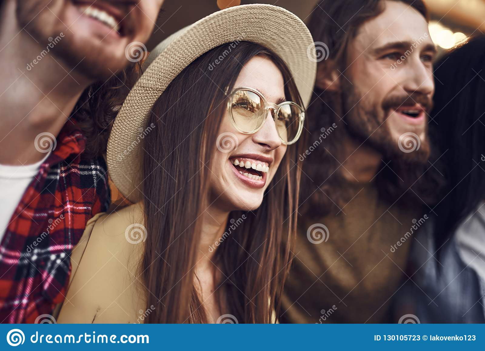 Close up of happy young lady being surrounded by friends