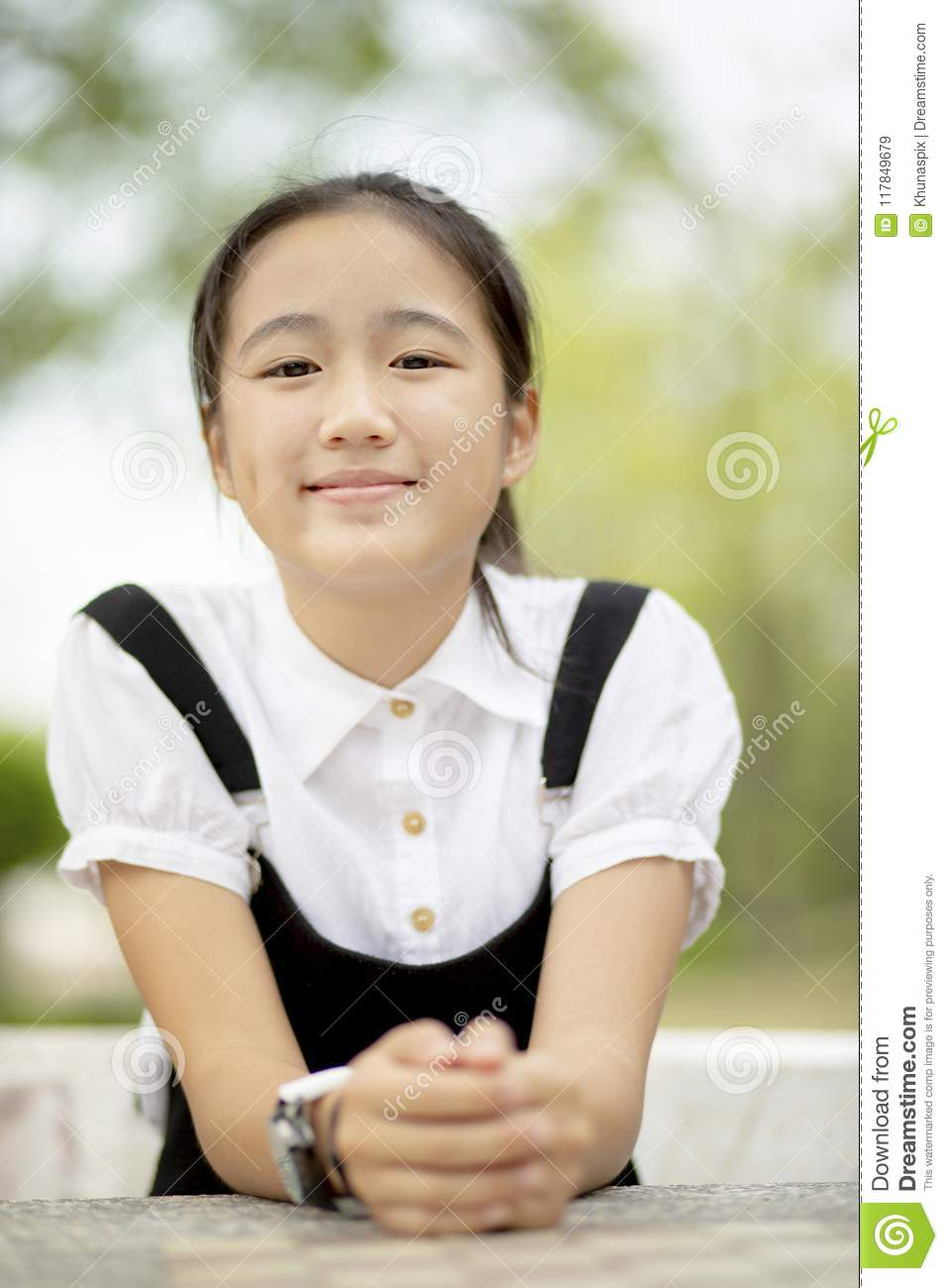 Close up head shop of asian teenager toothy smiling face outdoor