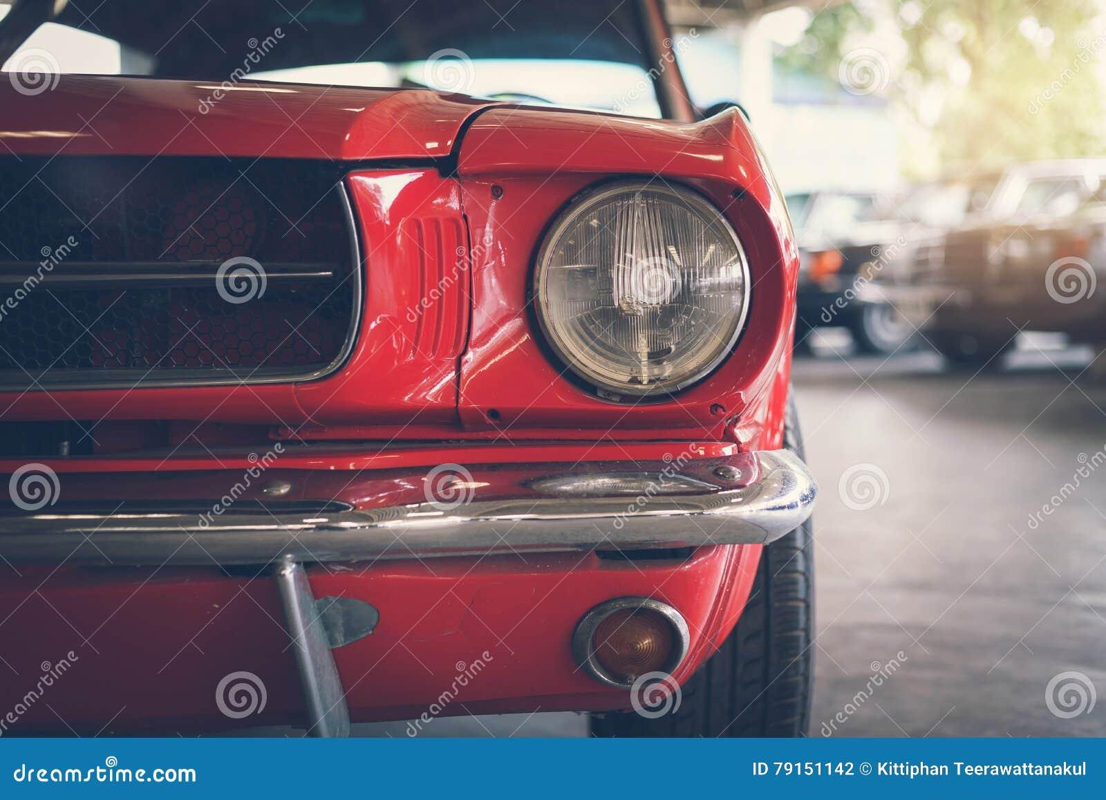 Vintage Auto Headlight Styles : Close up headlight of red retro classic car stock photo