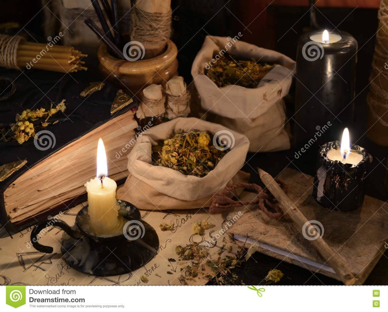 Close Up Of Healing Herbs, Alchemy Papers And Burning
