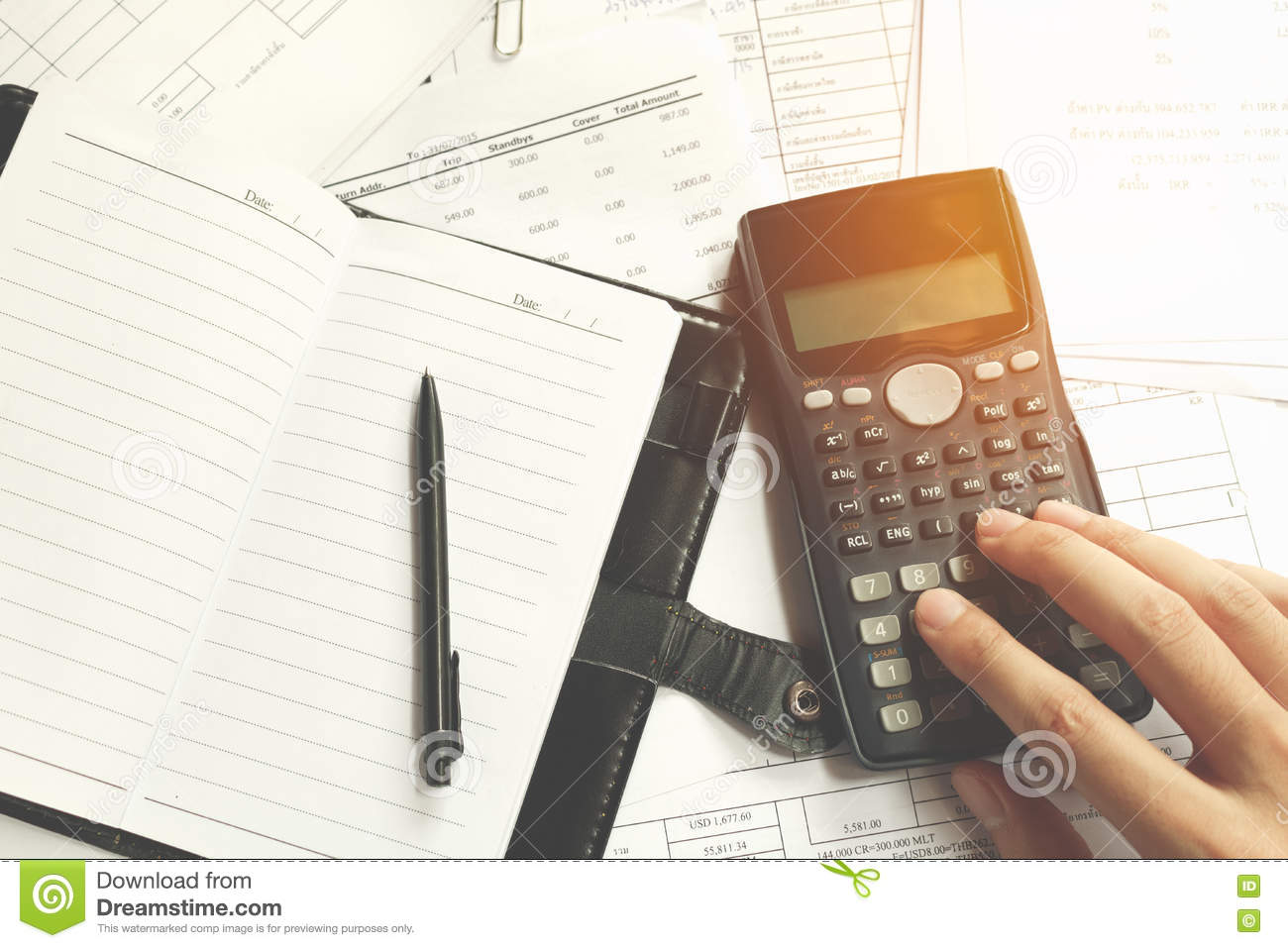 Close-up of Human accountant making calculations while sitting at desk in office