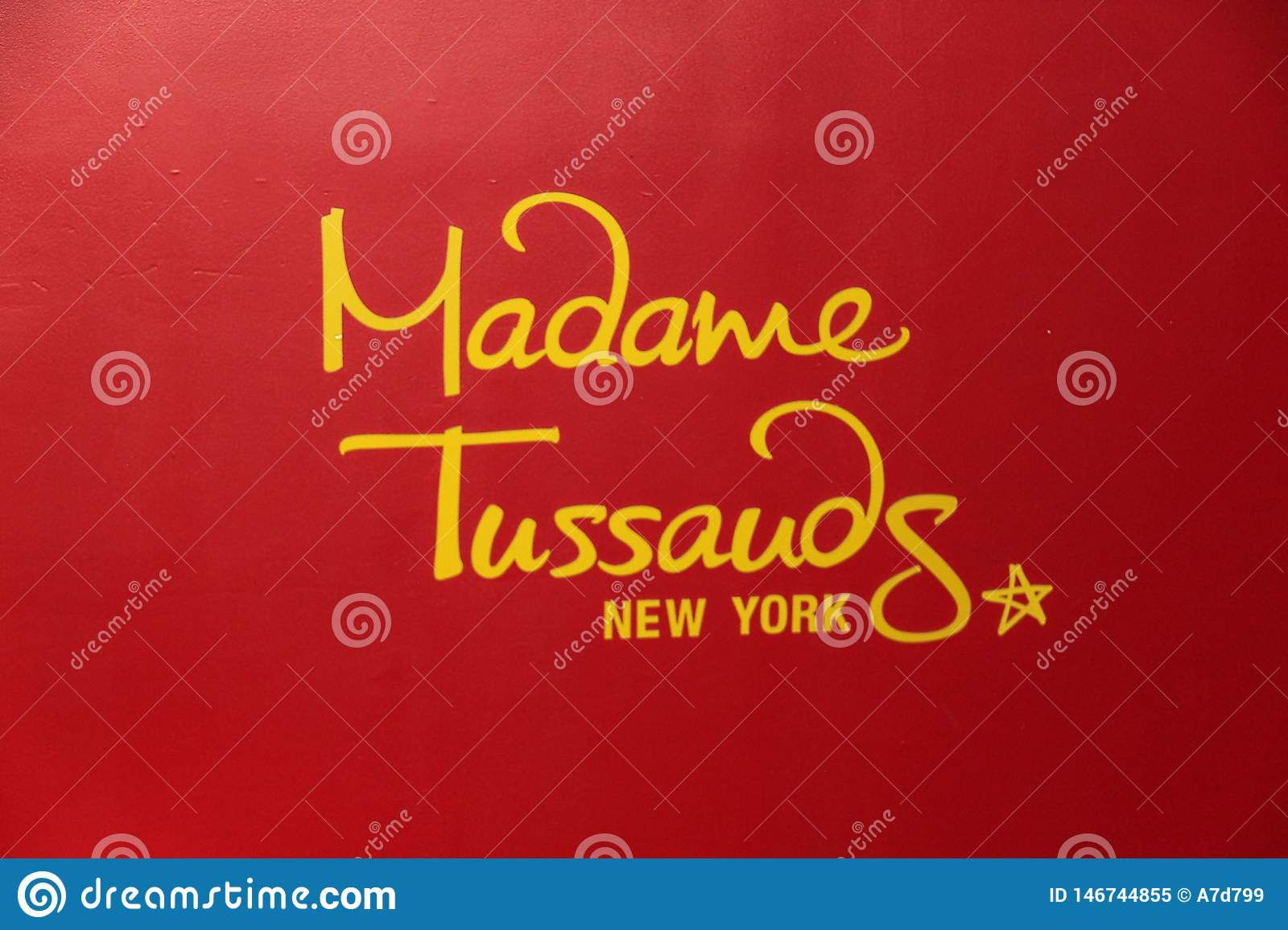 Close up iew of red signboard of famous Madame Tussauds museum.
