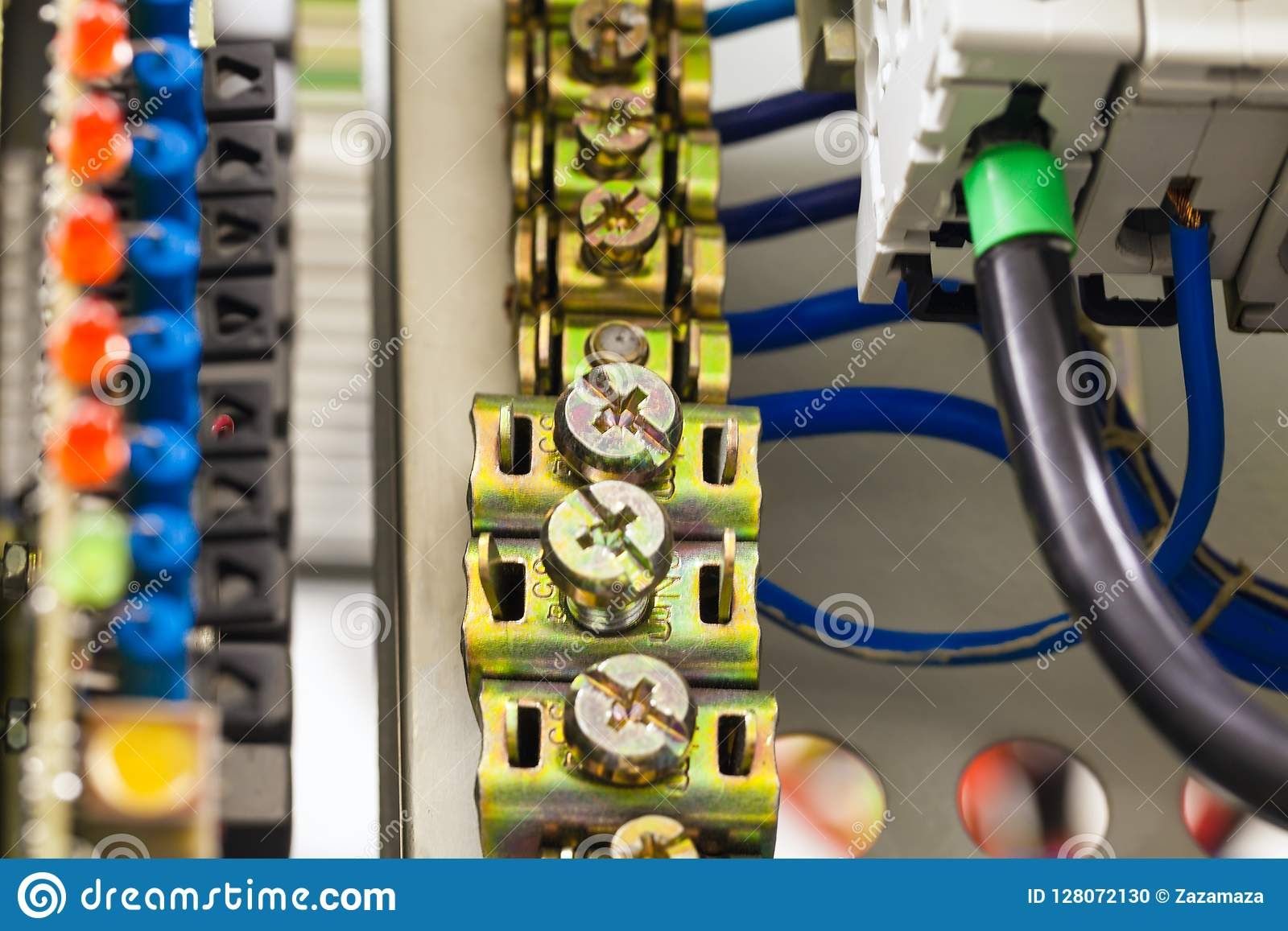 Close-up image of electrical wires is connected to cuprum clamps in power system of direct voltage with electrical