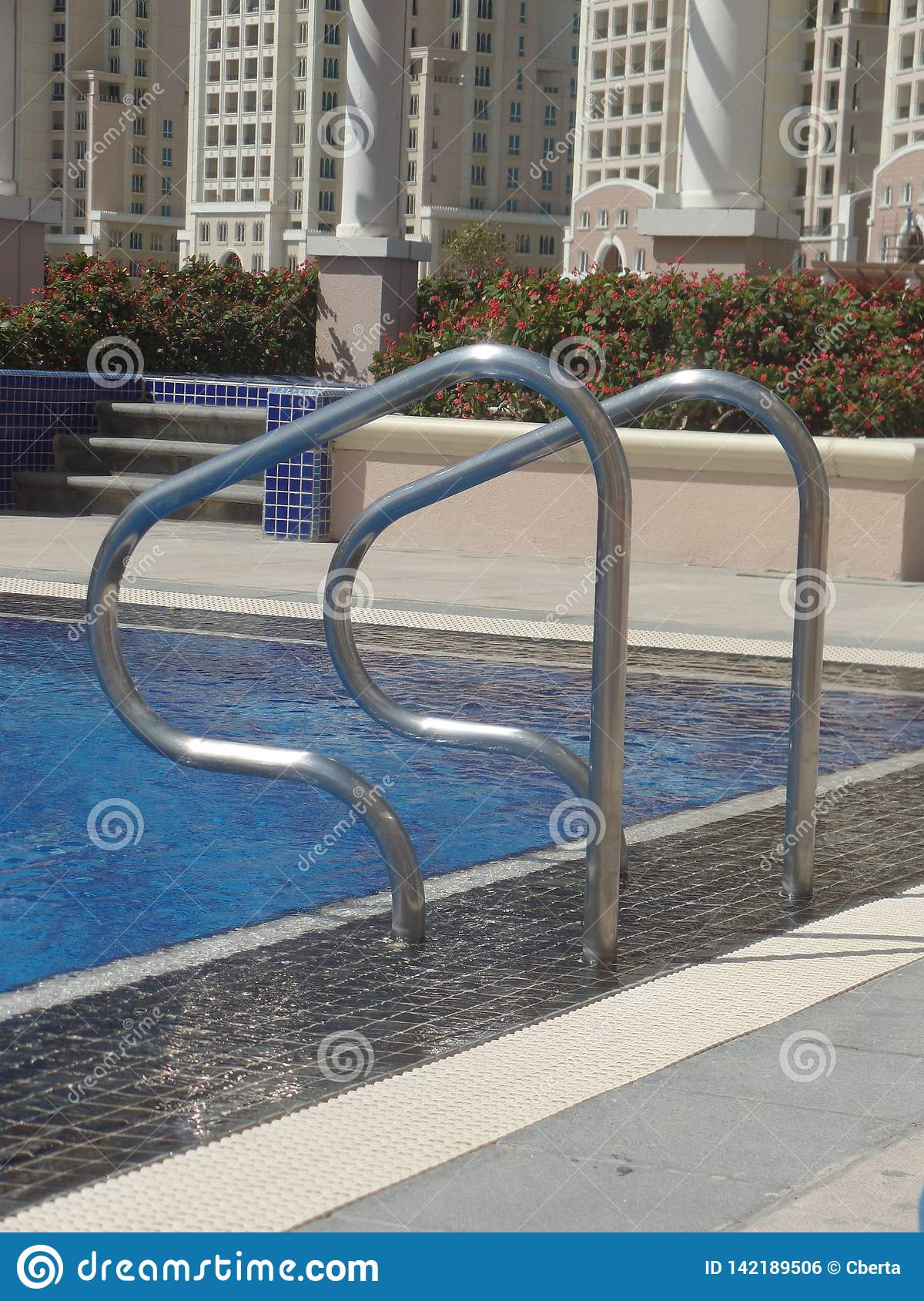 Close up image of swimming pool handrails